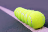 Tennis balls closeup on hard court synthetic tennis turf poster