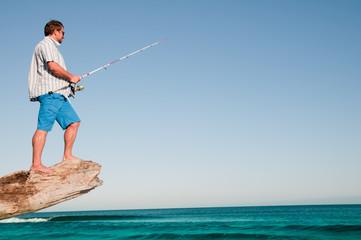 Fishing -  man fishing at the beach