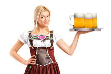 Woman wearing traditional costume and holding three beer glasses