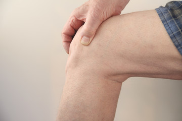 profile of a man's painful knee