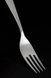Silver fork on dark background
