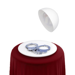 Round table with handcuff on a white dish.