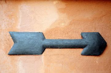 black arrow on wall