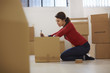 Caucasian woman moving to new apartment with boxes