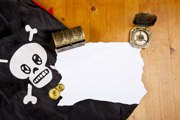 Pirate blank map with treasure, compass and flag with skull