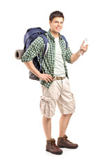 Full length portrait of a young hiker holding a bottle of water
