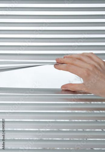 Hand opening venetian blinds for peeking