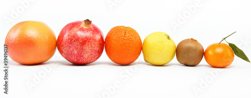 pomegranates and citrus fruits isolated on a white background.