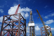 Jack Up Offshore Drilling Rig With Rig Cranes on Sunny Day in Th