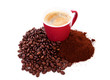 Cup in pile of roasted beans and regular coffee
