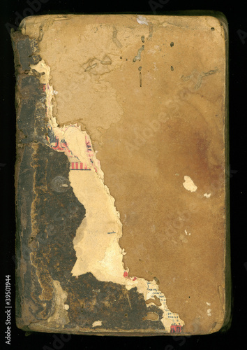 ancient grungy and tattered book cover