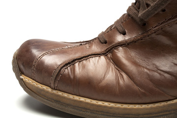 close up brown shoe on white background