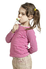 child on withe background with  lollipop