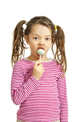 Close-up of adorable little girl with a lollipop,