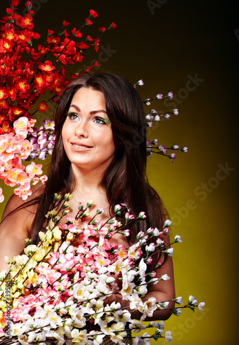 Girl holding spring flower.