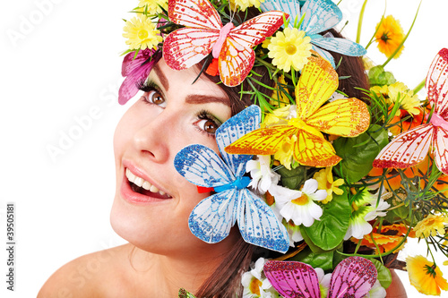 Girl with butterfly and flower on head.