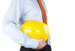 Close up of an engineer with hardhat isolated on white