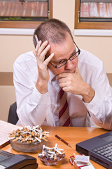 Worried businessman with cigarette