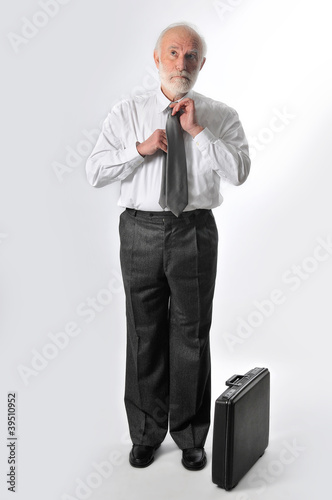 a man fixes his tie
