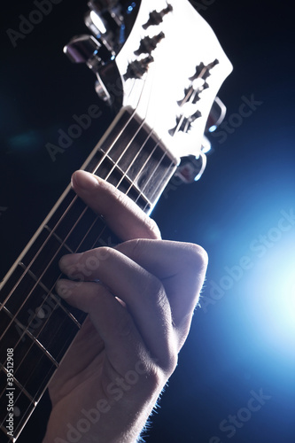 Musician playing on guitar