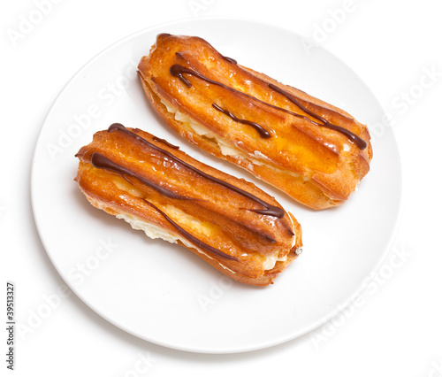 two eclairs on a white plate
