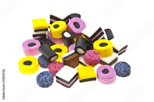 Liquorice allsort sweets in colourful abstract stack design isol