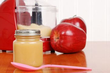 homemade apple sauce baby food with spoon
