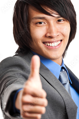 Businessman showing ok sing