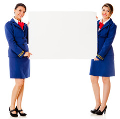Flight attendants with a banner