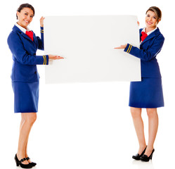 Air hostesses with a banner
