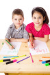 Two smiling kids draw for mum