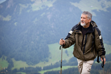 Active senior hiking in high mountains (Swiss Alps)