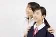 笑顔の女子中学生と塾講師