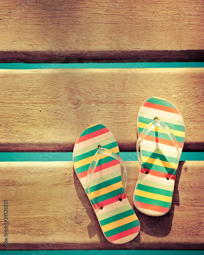 Beach flip flops on wood