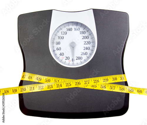 A bathroom scale with a measuring tape - 39526364