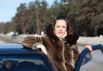 woman with her car in winter