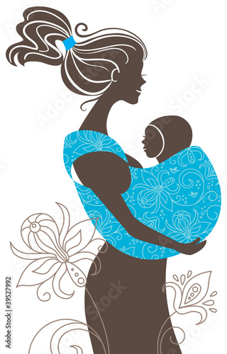 .Beautiful mother silhouette with baby in a sling
