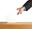 Hand putting a voting ballot in a slot of box isolated