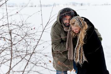 winter field strugle couple