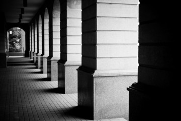 Perspective of a passage in contrasty black and white