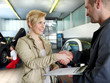 Female customer and mechanic shaking hands for good deal