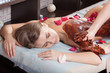 .cacao therapy applied to young woman in a spa