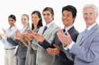 Close-up of multicultural business people applauding
