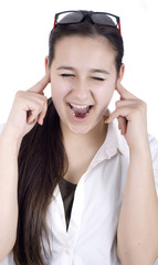 young woman suffers from noise pollution, covers his ears.
