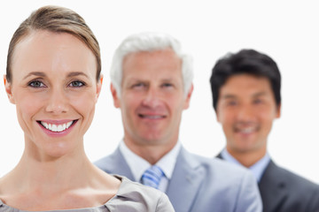 Close-up of smiling business people in a single line with focus on the woman