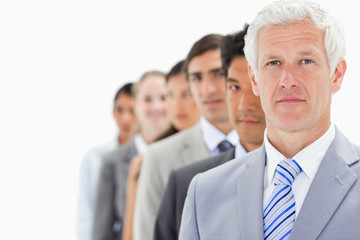 Close-up of a single line of business people with focus on the first person