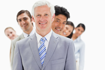 Business people smiling in a single line
