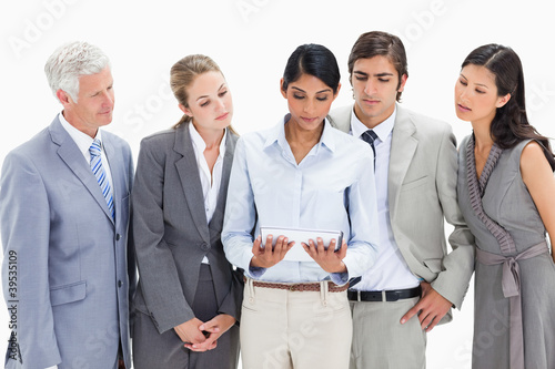 Business team watching a touchpad attentively