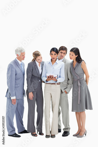 Speechless business people watching a touchpad