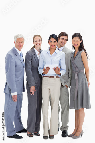 Smiling business team using a touchpad